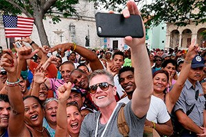 wellcome to americans in havana cuba taken a selfie with a smart phone