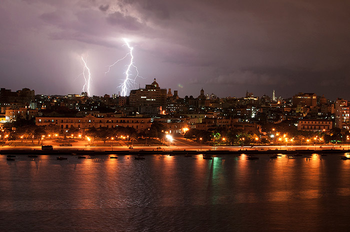 panoramic view of havana with rays and a strong storm